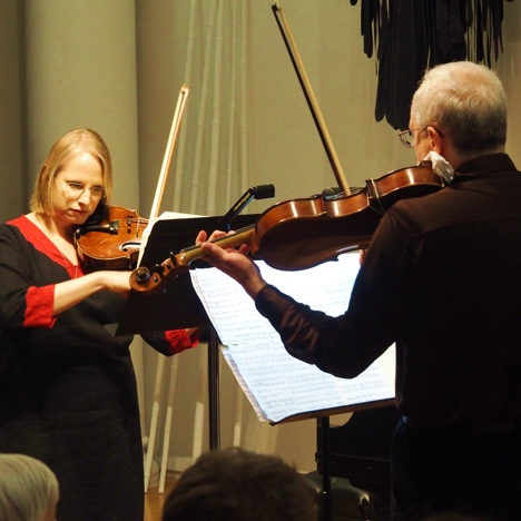 Photo of a violinist and violist from the GVO performing a duo