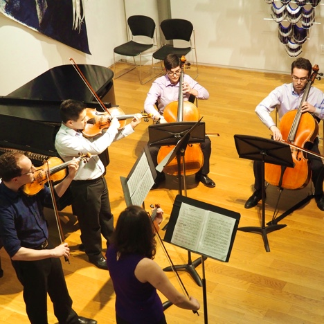 Photo of GVO members performing a string quintet